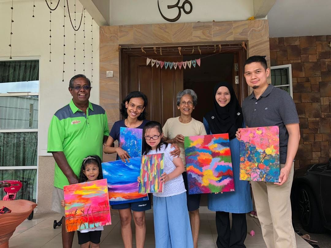 Dr Khairul Anuar Abdul Aziz (right) and his wife Sharifah Sarah Syed Mohamed Tahir (second from right) are proud of their daughter Maryam's artistic talents. - Sharifah Sarah Syed Tahir