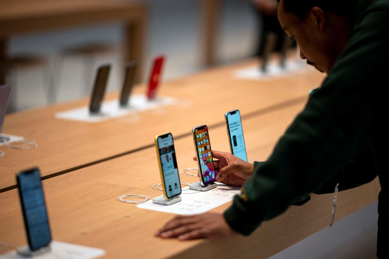 The iPhone 11 which was released in 2019 is now RM1,000 cheaper after the release of the latest iPhone 13. — AFP